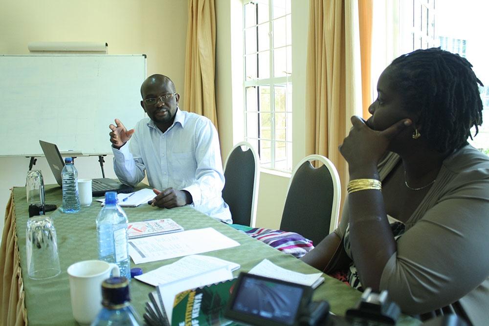 Mr Fred Ochoti presenting his findings on gender issues in Westlands, Nairobi