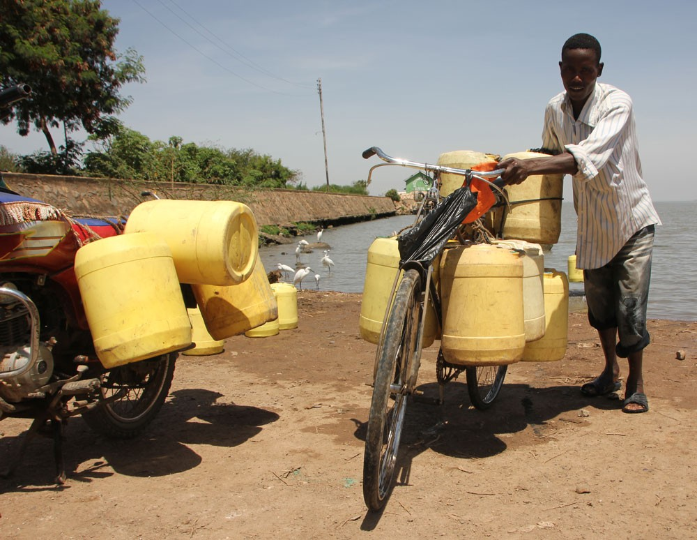 A man drawing water from Lake Victoria for domestic use. Challenge of access to clean water remains at the grassroots in Kenya despite two years of devolution.